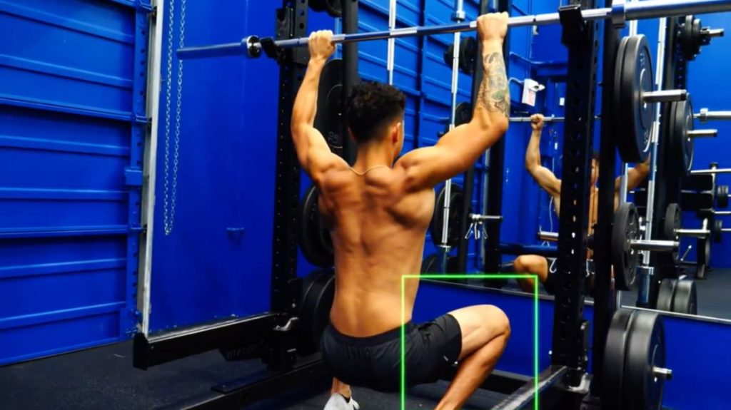 Use a barbell if you don't have access to a cable machine for a kneeling pull down exercise